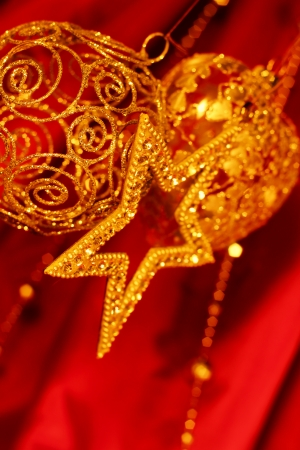 Golden christmas decoration on red fabric background photo