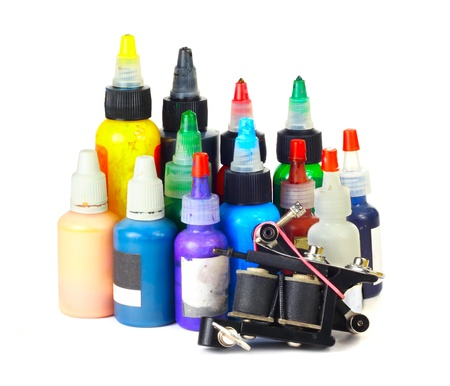Tattoo machine with many color ink bottles isolated white background Stock Photo - 16928634