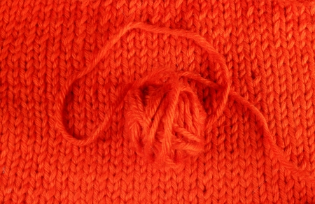 Wool yarn and knitted textile macro close up photo