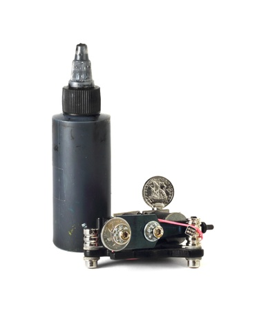 Tattoo Supplies - machine and black ink in bottle Stock Photo - 17036126