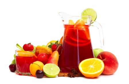 Refreshing fruit sangria in jug with different fruits solated on white photo