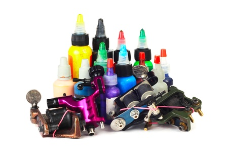Tattoo machine with many color ink bottles isolated white background Stock Photo