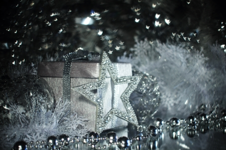 Silver christmas gift and different shiny decoration Stock Photo - 20113030