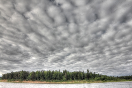 Picturesque landscape with forest and wide river photo