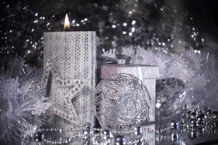 Silver christmas gift and different shiny decoration photo
