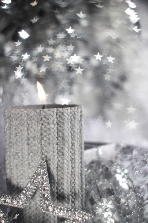 Christmas candle with gift and different silver decoration photo