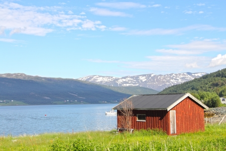 Beautiful Village in fjord coast of northern Norway photo