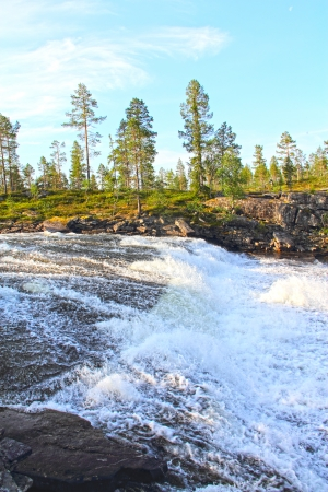 Wild glacier river in summer sunny day, Norway photo