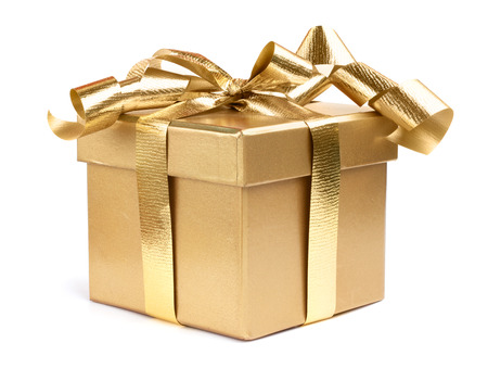 Golden gift box decotated with ribbon isolated on white background