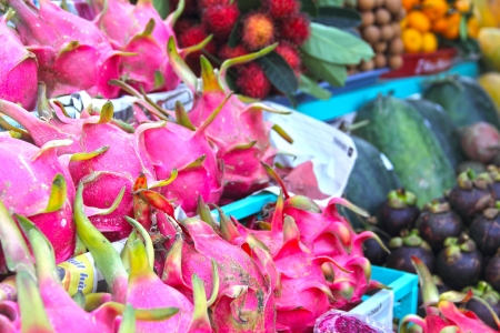 Exotic fruits on asian market close-up photo