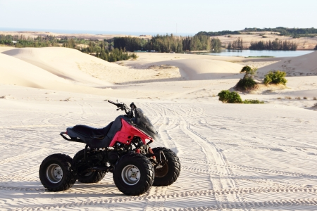 Quad bike in sand desert close-up Stock Photo