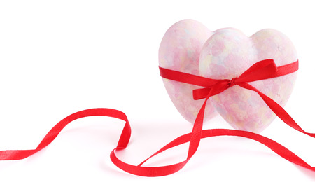Two hearts tied with ribbon isolated on white background Stock Photo