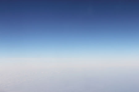 View from over a  layer of thick soft clouds photo