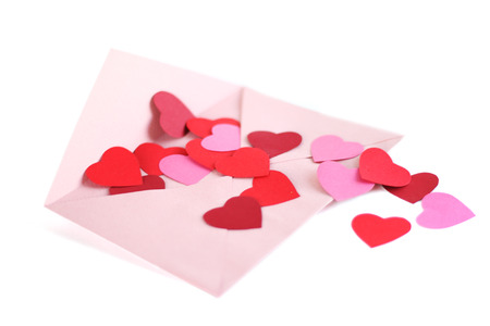 Envelope with red hearts for valentine day on white background photo