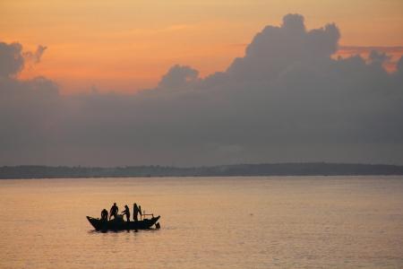 Beautiful view on Fishing asian Boat at Sunrise photo
