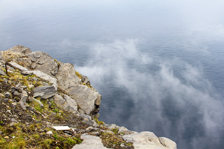 View from Nordkapp with mountain and mist Stock Photo