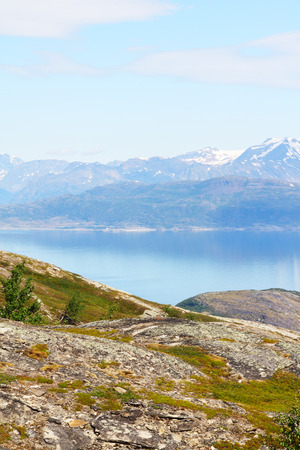 Scenic panorama of fjord on in northern Norway on sunny summer day photo