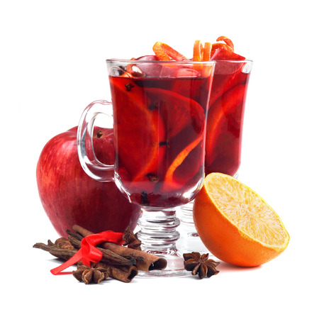 Hot red mulled wine with fruits and cinnamon isolated on white  Stock Photo