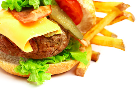 Exploded view of hamburger with french fries isolated on white  photo