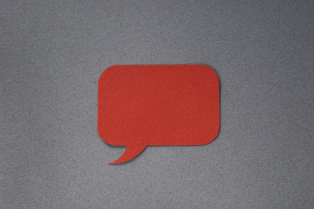Red paper dialog box on gray background with blank empty copy space photo