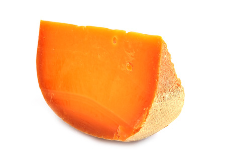 Portion of Mimolette Cheese isolated on white background