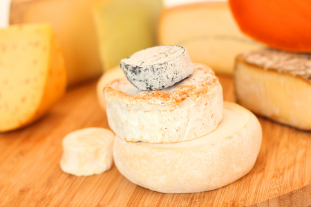 French cheese collection on wooden board with copy space photo