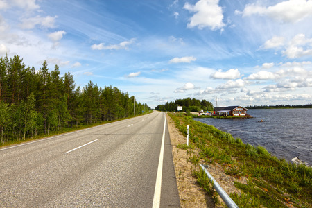 Summer landscape with road, gulf and forest photo