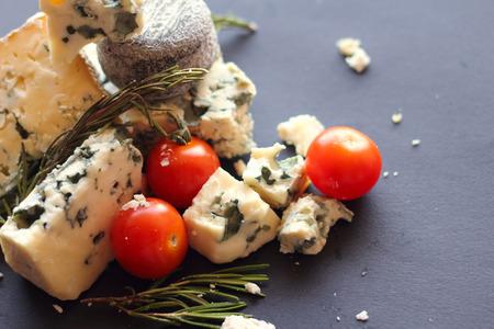 roquefort: Roquefort cheese composition on dark background