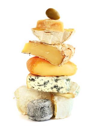 白い背景に分離されたチーズの盛り合わせのスタック 写真素材
