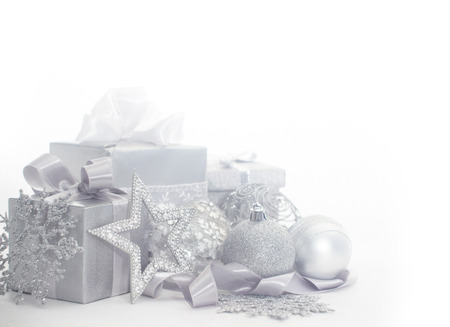 Silver christmas card with gifts and decoration photo