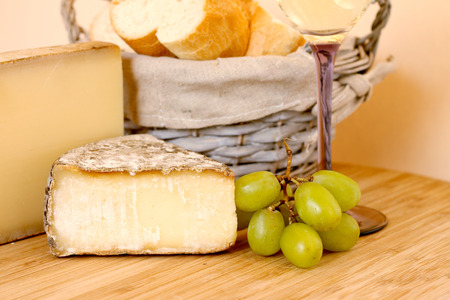Composition with french wine, cheese and grape on wooden table photo