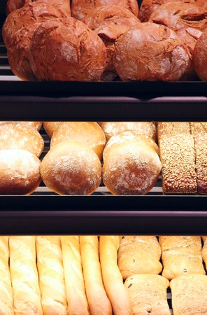 Bread on showcase in supermarket, close-up view photo