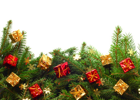 Christmas Border of fir tree branches with golden and red gifts and snowflakes isolated on white background Stock Photo