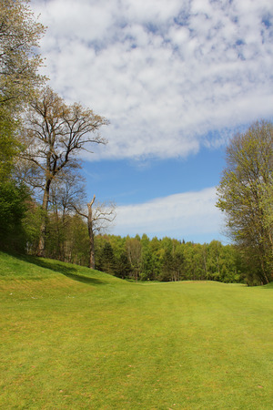 blue sky and fields: Beautiful french landscape with golf course in springtime