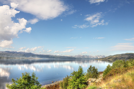 Scenic panorama of fjord and mountains in northern Norway photo