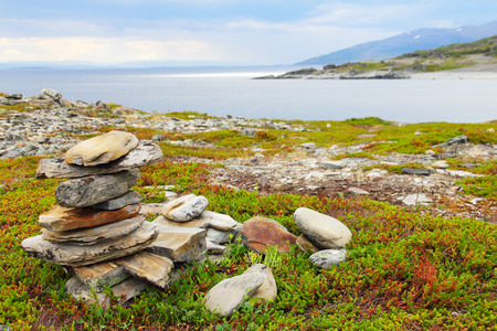 Northern Norwegian landscape with stack of stones photo