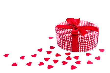 Valentines day gift and paper hearts isolated on white background photo
