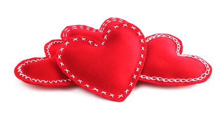 Red fabric handmade Valentines day hearts isolated on white background photo