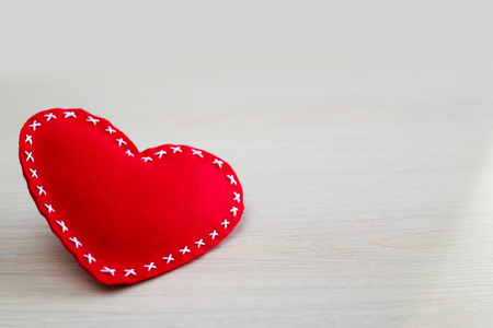 Valentines day heart on wooden background with copy space photo