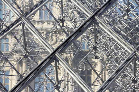 louvre pyramid: Paris - Detail of the Louvre Pyramid close to main entrance Stock Photo