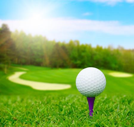 背景にぼやけて景観とコースにゴルフ ・ ボール 写真素材