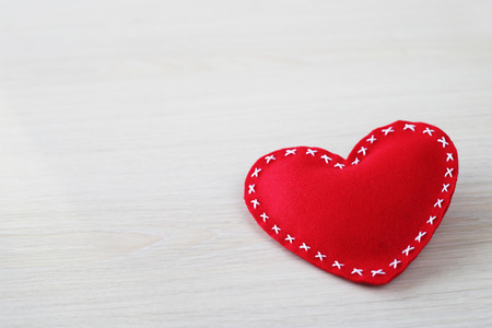 holiday symbol: Valentines day heart on wooden background with copy space