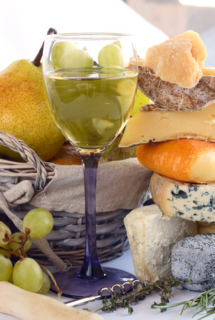 French Cheese, wine and fruits conceptual composition photo