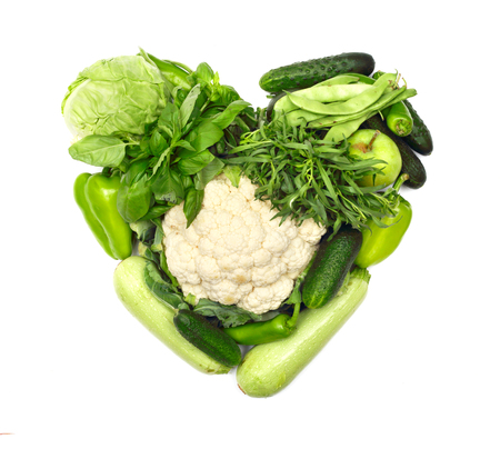 love shape: Pile of vegetables shaped as heart isolated on white background Stock Photo