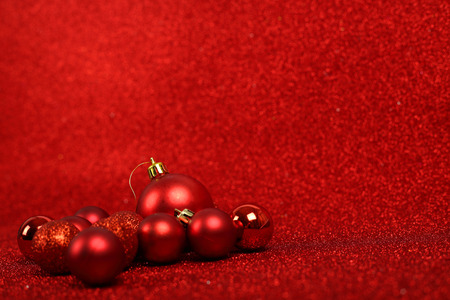'christmas ball': Red Christmas balls over red glitter background with copy space