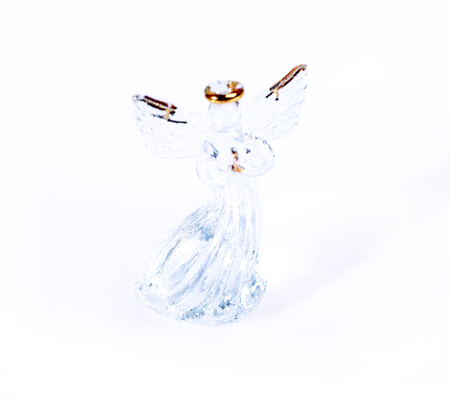 crystal background: Crystal angel figurine isolated on white background