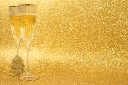 christmas bubbles: Champagne and christmas decor on golden glitter background with copy space