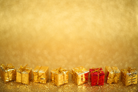 gold gift box: Holiday gift boxes on shiny golden background with copy space