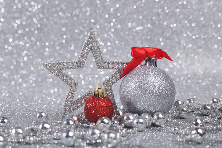 christmas decor: Christmas decor on shiny glitter silver background with copy space