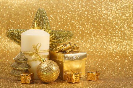 star ornament: Beautiful christmas candle on golden glitter background with copy space Stock Photo